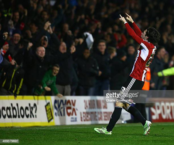 Jota of Brentford celebrates after scoring winning goal late on during the Sky Bet Championship match between Brentford and Fulham at Griffin Park on...