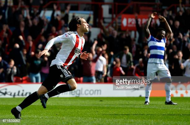 Jota of Brentford celebrates scoring the third Brentford goal during the Sky Bet Championship match between Brentford and QPR at Griffin Park on...