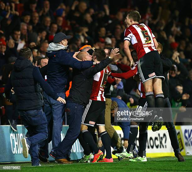 Jota of Brentford celebrates with team mates and fans after scoring winning goal late on during the Sky Bet Championship match between Brentford and...