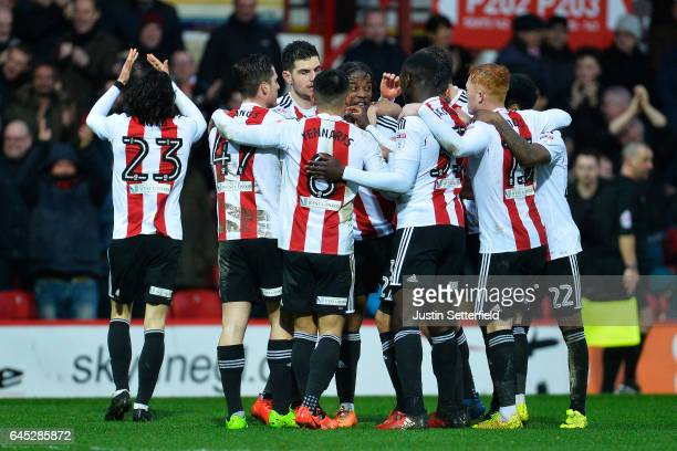 Jota of Brentford FC celebrates scoring the fourth Brentford goal with team mates during the Sky Bet Championship match between Brentford and...