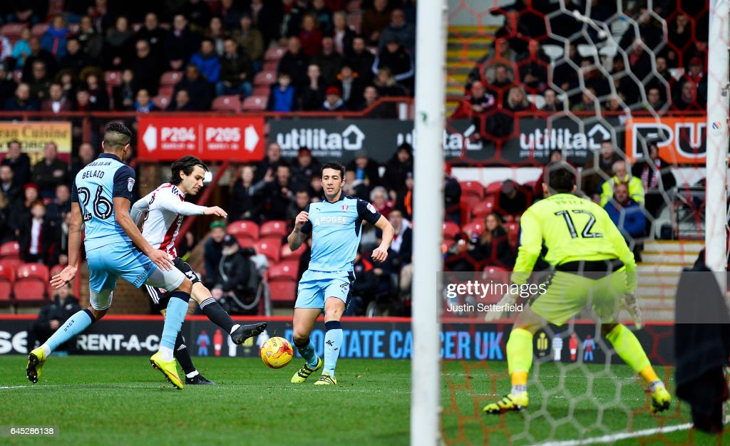 Jota of Brentford FC scores the first Brentford during the Sky Bet Championship match between Brentford and Rotherham at Griffin Park on February 25, 2017 in Brentford, England.