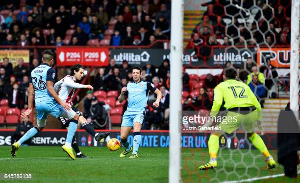 Jota of Brentford FC scores the first Brentford during the Sky Bet Championship match between Brentford and Rotherham at Griffin Park on February 25...