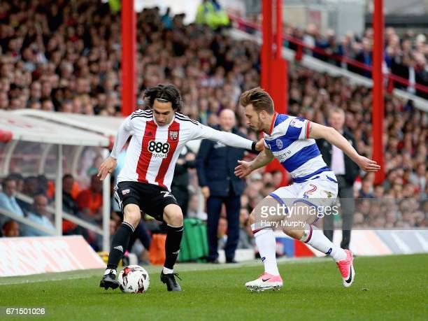 Jota of Brentford is closed down by Luke Freeman of Queens Park Rangers during the Sky Bet Championship match between Brentford and Queens Park...