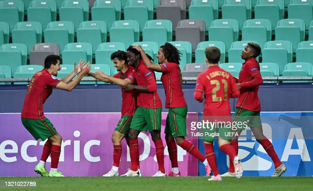 Jota of Portugal celebrates with team mates after scoring their side's fourth goal during the 2021 UEFA European Under-21 Championship Quarter-finals...