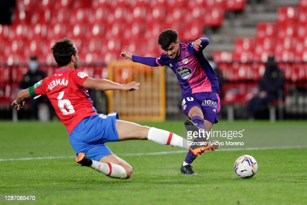 Jota of Real Valladolid scores their sides third goal whilst under pressure from German Sanchez of Granada CF during the La Liga Santander match...