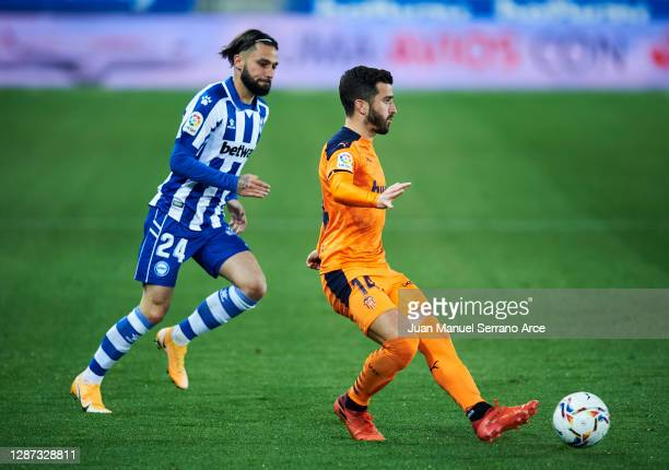 Jota Peleteiro of Deportivo Alaves duels for the ball with Jose Gaya of Valencia CF during the LaLiga Santander match between Alaves and Valencia on...