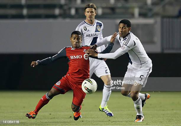 Jou Plata of the Toronto FC David Beckham and Sean Franklin of the Los Angeles Galaxy pursue the ball in the first half during a CONCACAF Champions...