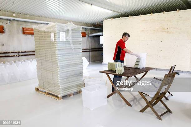 Jouko Siikonen farmer prepares plastic containers to grow crickets at the Siikonen family farm in Forssa Finland on Tuesday June 26 2018 On their...