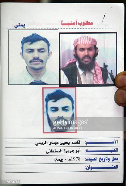A jounalist holds up a Yemeni interior ministry document marked on top in red wanted and showing three different undated pictures of a suspected...