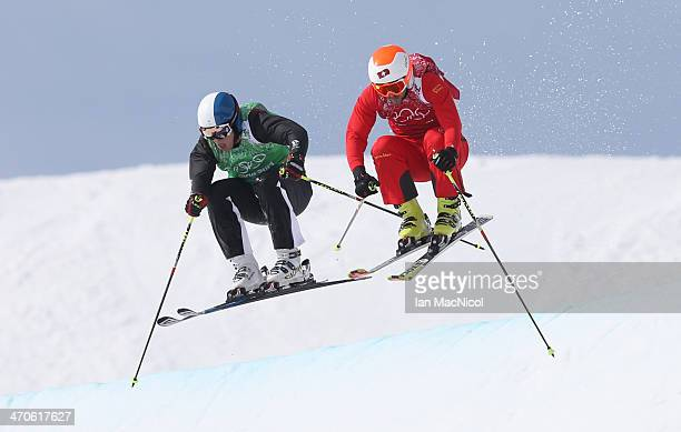 Jouni Pellinen of Finland and Armin Niederer of Switzerland compete in the Men's Ski Cross 1/8 Finals on day 13 of the 2014 Winter Olympics at Rosa...