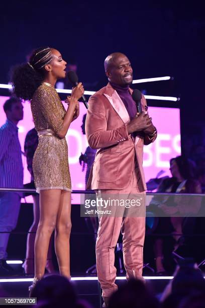 Jourdan Dunn and Terry Crews present on stage during the MTV EMAs 2018 on November 4 2018 in Bilbao Spain