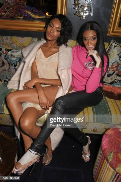 Jourdan Dunn and Winnie Harlow attend the LOVE magazine x Miu Miu party held during London Fashion Week at Loulou's on September 18 2017 in London...