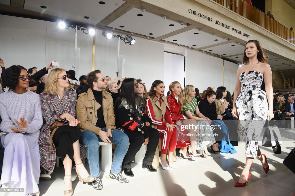 Jourdan Dunn, Eva Herzigova, Derek Blasberg, Law Roach, Zendaya, Blake Lively, and Emily Blunt watch Bella Hadid walk the runway during the Michael Kors Collection Fall 2018 Runway Show at Vivian Beaumont Theatre at Lincoln Center on February 14, 2018 in New York City.