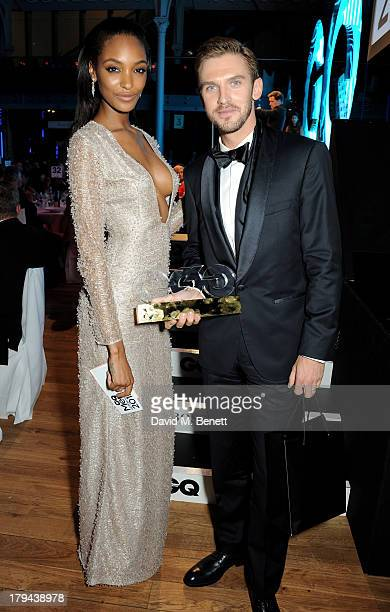 Jourdan Dunn poses with winner Dan Stevens at the GQ Men of the Year awards at The Royal Opera House on September 3 2013 in London England