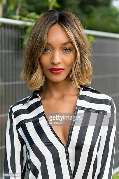 Jourdan Dunn prepares backstage at the Burberry Prorsum show during London Fashion Week Spring Summer 2015 on September 15 2014 in London England