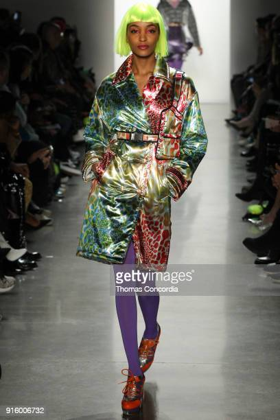 Jourdan Dunn walks the runway wearing Jeremy Scott Fall 2018 with make up by Kabuki for MAC and hair by Eugene Souleiman for Wella at Spring Studios...
