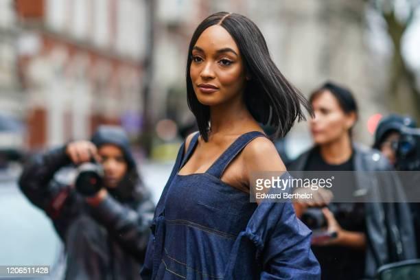 Jourdan Dunn wears a blue denim dress, during London Fashion Week Fall Winter 2020, on February 15, 2020 in London, England.