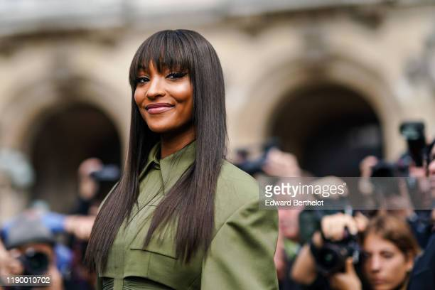 Jourdan Dunn wears a green dress, outside Balmain, during Paris Fashion Week - Womenswear Spring Summer 2020, on September 27, 2019 in Paris, France.