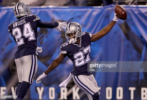 Jourdan Lewis of the Dallas Cowboys celebrates his touchdown with teammate Chidobe Awuzie after Lewis recovered a fumble by the New York Giants in...