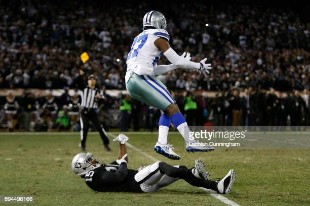Jourdan Lewis of the Dallas Cowboys is flagged for pass interference on Michael Crabtree of the Oakland Raiders during their NFL game at...