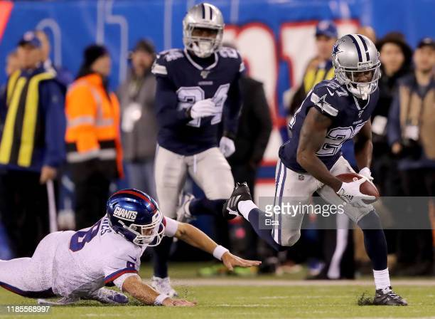 Jourdan Lewis of the Dallas Cowboys recovers a fumble and runs it in for the touchdown in the fourth quarter as Daniel Jones of the New York Giants...