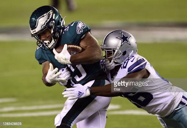 Jourdan Lewis of the Dallas Cowboys tackles running back Boston Scott of the Philadelphia Eagles in the second quarter of the game at Lincoln...