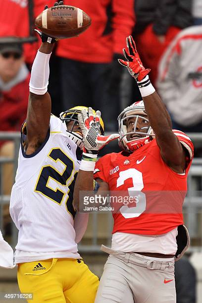 Jourdan Lewis of the Michigan Wolverines breaks up a pass in the end zone intended for Michael Thomas of the Ohio State Buckeyes in the second...