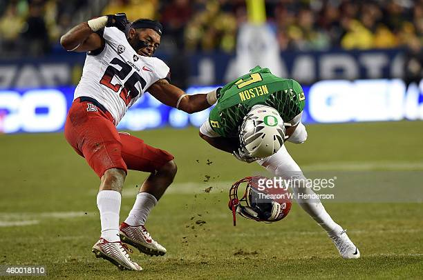 Jourdon Grandon of the Arizona Wildcats loses his helmet while defending Charles Nelson of the Oregon Ducks in the first half of the PAC12...