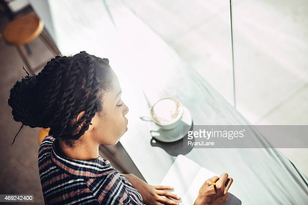 journaling woman with coffee in cafe - diary stock pictures, royalty-free photos & images