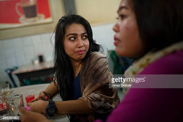 Journalism graduate Hemi Faradila comes to the cafe in Uleh Kareng She explained how she was here for a protest against Sharia law The tsunami of...