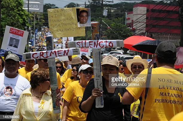 Journalism students take part in a demonstration demanding punishment for the killers of HRN la Voz de Honduras' journalist Alfredo Villatoro during...