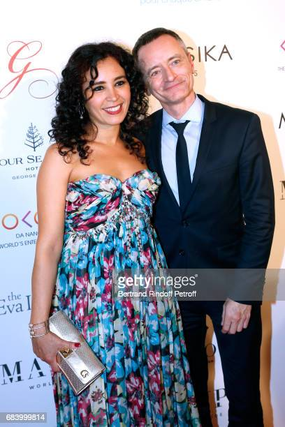 Journalist Aida Touihri and Gael Hamayon the 'Global Gift the Eva Foundation' Gala Photocall at Hotel George V on May 16 2017 in Paris France