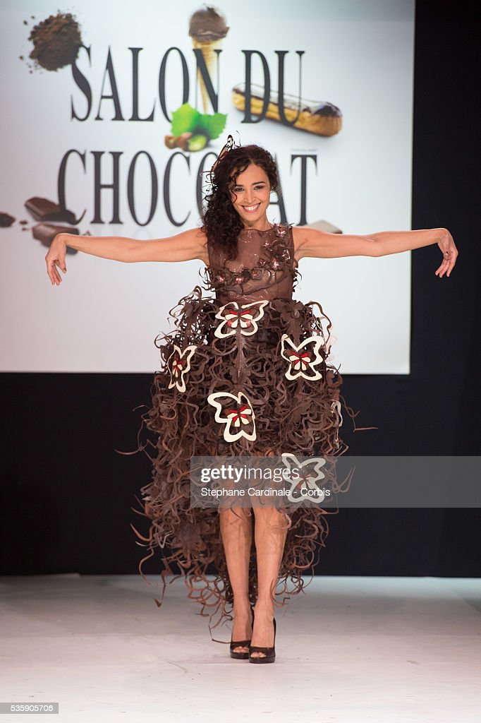 Journalist Aida Touihri walks the runway and wears 'L'Alchimie de la Nature' a chocolate dress made by designer Lauren Bitar and chocolate maker Arnaud Larher during the Fashion Chocolate Show at Salon du Chocolat at Porte de Versailles, in Paris.
