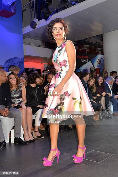 TV journalist Aida Touihri walks the runway during the Christophe Guillarme show as part of the Paris Fashion Week Womenswear Spring/Summer 2016 on...