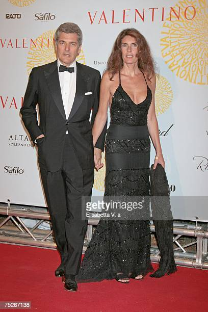 Journalist Alain Elkann and his wife Rosy Greco arrive at the post haute couture show gala dinner and ball in the Parco dei Daini at the Villa...