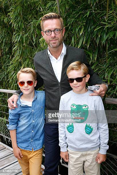 Journalist Alexandre Delperier with his sons Louis and Valentin attend the 2015 Roland Garros French Tennis Open at Roland Garros on May 24 2015 in...