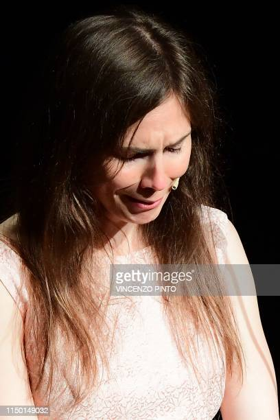 """Journalist Amanda Knox cries as she addresses a panel discussion titled """"Trial by Media"""" during the Criminal Justice Festival at the Law University..."""