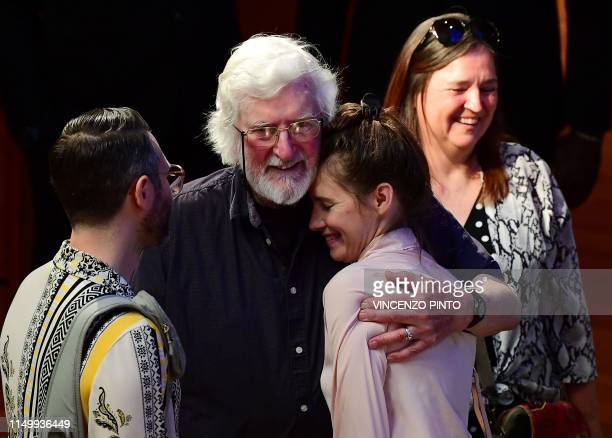 US journalist Amanda Knox is embraced by Peter Pringle the last men to be sentenced to hanging in Ireland next to her boyfriend US author Chris...