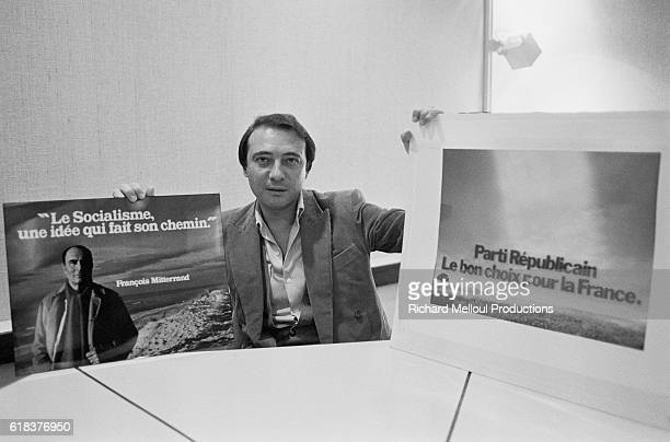 Journalist and advertising conceptor Jacques Seguela holds up examples of two campaign posters he has worked on One advertisement is for the...