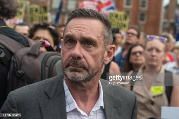Journalist and author Paul Mason on College Green during a protest against the government proroguing parliament on August 28 2019 in London England...