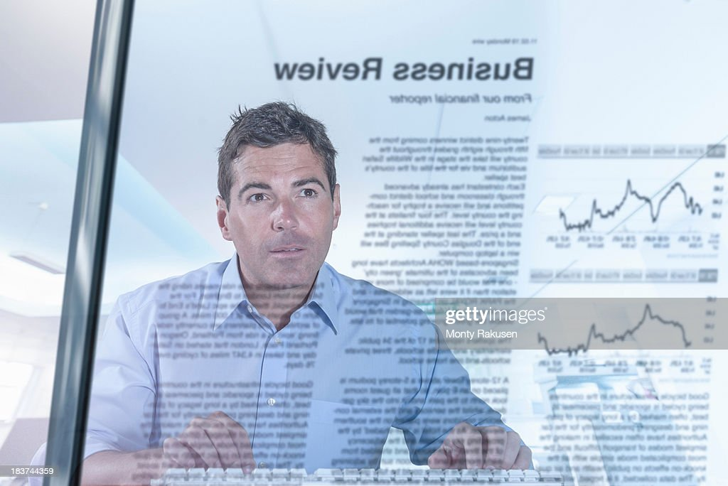 Journalist and blogger reading news, view through screen : Stock Photo