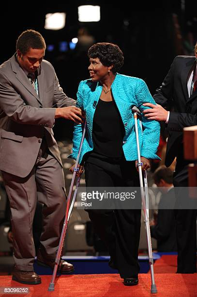 PBS journalist and debate moderator Gwen Ifill is helped off of the stage after moderating the vice presidential debate with Democratic vice...