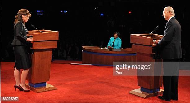 PBS journalist and debate moderator Gwen Ifill looks on as Democratic vice presidential candidate US Senator Joe Biden and Republican vice...