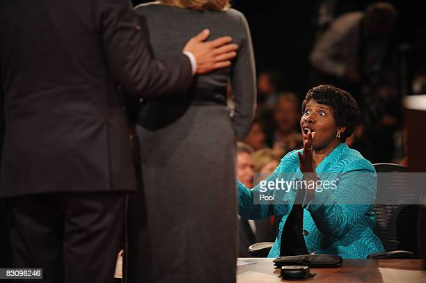 PBS journalist and debate moderator Gwen Ifill speaks to people after moderating the vice presidential debate with Democratic vice presidential...