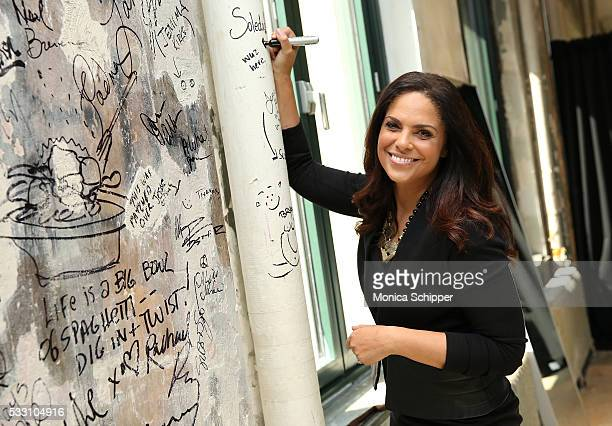Journalist and exeutive producer Soledad O'Brien signs the wall at AOL Studio when she visits for AOL Build Presents Soledad O'Brien Presents The War...