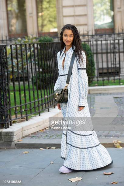 Journalist and Film maker Fenn O'Meally wears an Erdem dress Chloe bag and Nike trainers during London Fashion Week September 2018 on September 17...