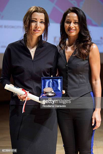 Journalist and novelist Rula Jebreal and Writer Elif Shafak pose with the 'Sigillo of the city of Milan during the Bookcity Milan 2016 on November 17...