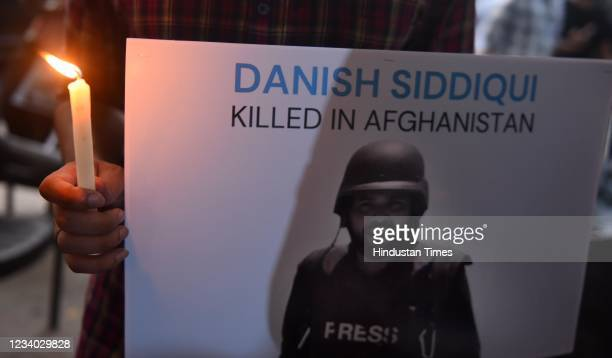 Journalist and Photojournalists light candles in memory of Reuters Chief Photo Journalist Danish Siddiqui who was killed in Kandhar Afghanistan in...