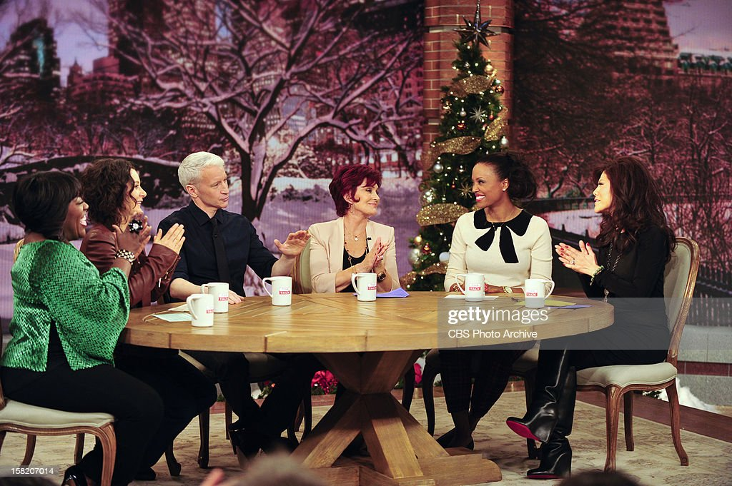 Journalist and television host Anderson Cooper joins the hosts of THE TALK as a guest while the show broadcasts from New York City, Monday, December 10, 2012 on the CBS Television Network. Sheryl Underwood, from left, Sara Gilbert, Anderson Cooper, Sharon Osbourne, Aisha Tyler and Julie Chen, shown.
