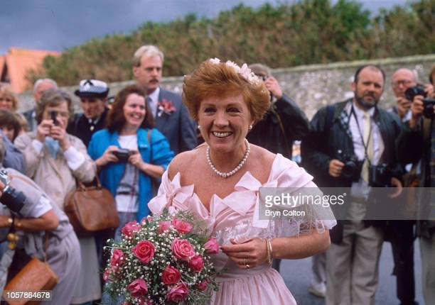 Journalist and Television presenter Anne Robinson as chief bridesmaid attends the wedding of English tabloid editor Derek Jameson and Ellen Petri at...